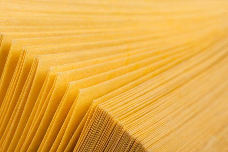 Close-up abstract view of yellow pages book