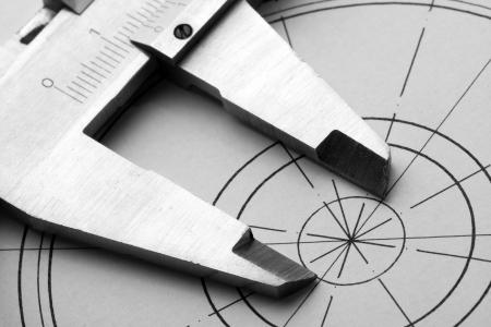 dibujo tecnico: Primer plano de dibujo t�cnico y la pinza Foto de archivo