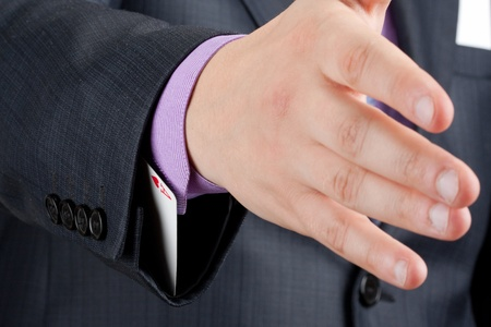 Businessman is going to handshake with ace up in sleeve Stock Photo - 18364858