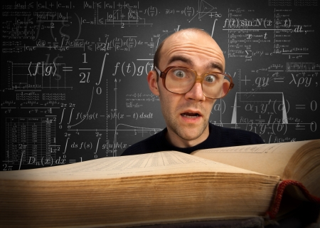 scientific literature: Surprised nerd student looking to textbook on math Stock Photo
