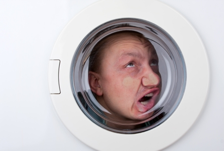 stuck: Close-up of bizarre man inside washing machine