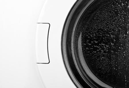Close-up of washing machine door. In B/W Stock Photo - 18363480