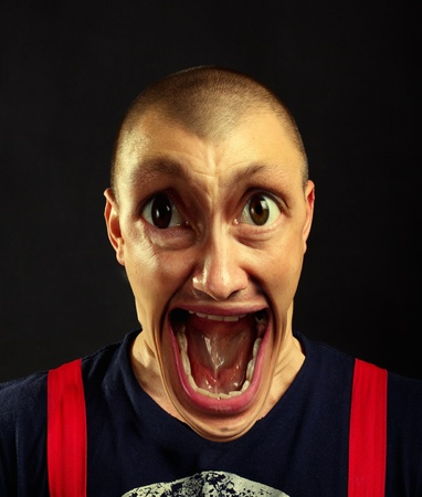 preasure: Portrait of very surprised screaming man with giant eyes and open mouth
