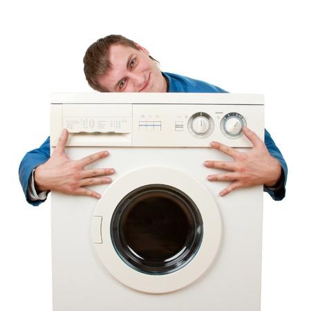 Repairman embraces washing machine. Isolated on white Stock Photo - 18358837