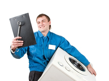 Repairman servicing washing machine. Isolated on white photo