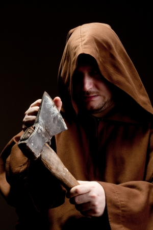 axes: Terrify medieval executioner checking the axe sharpness