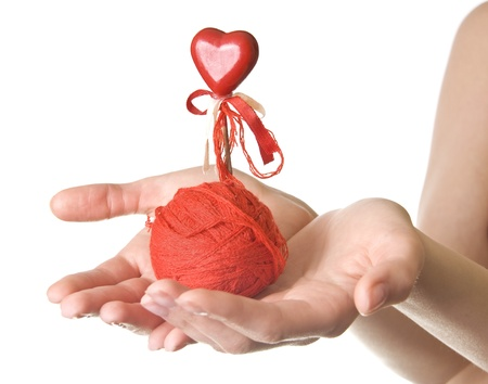 sense of space: Hands with red ball of threads and heart