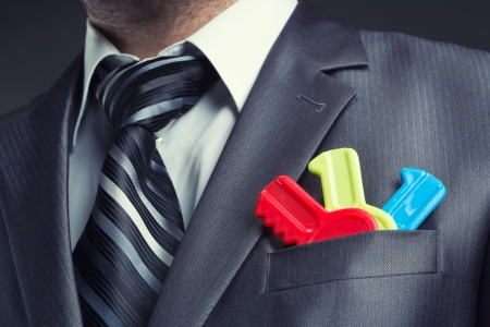 Businessman with colorful toy keys in suit pocket Stock Photo - 18400940