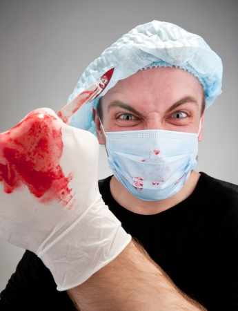 soiled: Mad mental sick blood soiled surgeon with knife