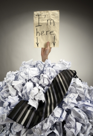 bureaucracy: Businessman buried in big heap of crumpled papers