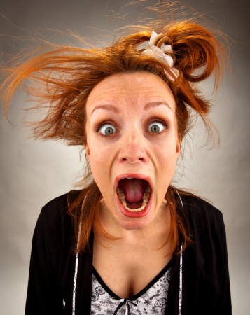 goofy: Portrait of very surprised bizarre screaming housewife
