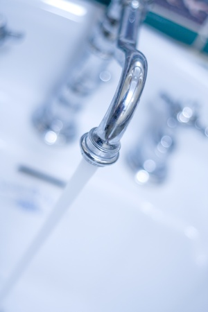 Running faucet. Toned Stock Photo - 18396328