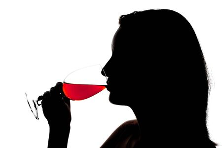 social event: Silhouette of woman degusting wine. Isolated on white Stock Photo