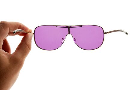Wishful thinking concept. Hand holding pink sunglasses. Isolated on white Stock Photo - 18396185