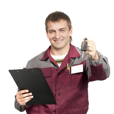 auto shop: Mechanic with clipboard giving a car key. Isolated on white Stock Photo