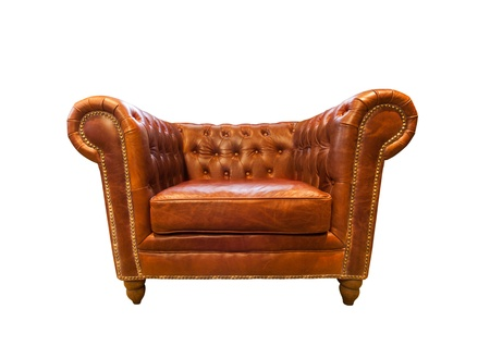 Vintage brown leather armchair isolated on white photo
