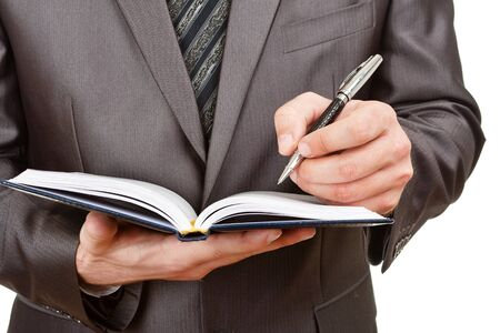 Businessman writing in business diary. Isolated on white Stock Photo - 18400814