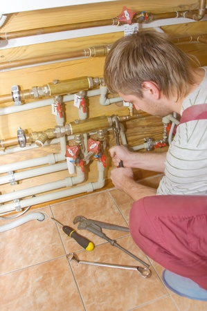 Plumber at work. Servicing water & heating systems Stock Photo - 18397012