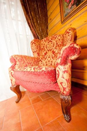Red retro chair near the window Stock Photo - 18400677