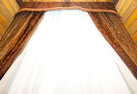 Retro curtains with top panel against window photo