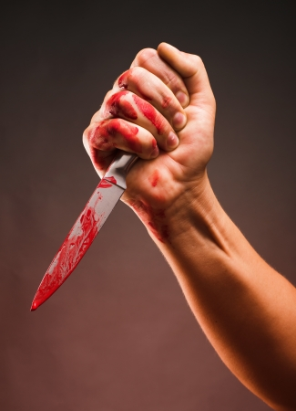 Bloody stabbing. Hand with knife photo