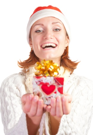 Happy smiling woman in christmas hat with gift. Isolated on white Stock Photo - 18396349