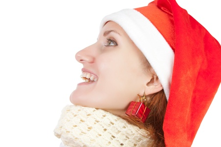 Smiling woman in christmas hat and scarf isolated on white Stock Photo - 18396759