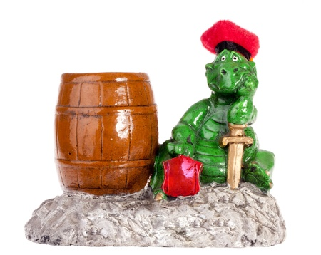 Statuette of funny dragon with barrel. Isolated on white Stock Photo - 18396380