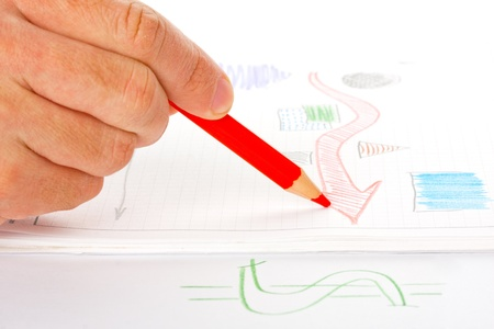 Businessman sketching success diagram by red pencil photo