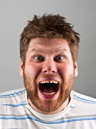 unshaved: Portrait of a ugly angry screaming man