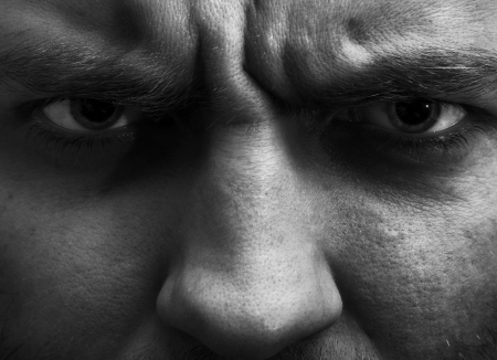 intense: Close-up portrait of angry man. In BW Stock Photo