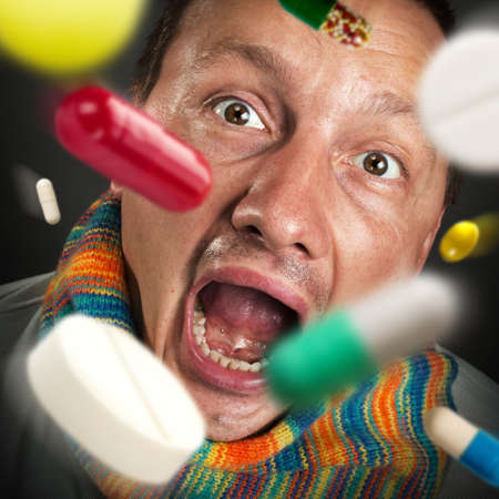Various colorful pills falling into open mouth Stock Photo - 18400592