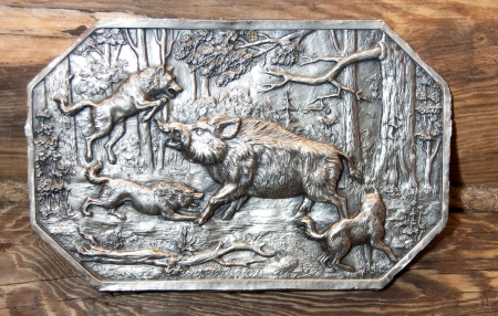 Silver engraving on the wall. Hunt scene in forest photo