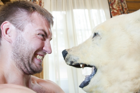 Man vs polar bear. Head to head photo