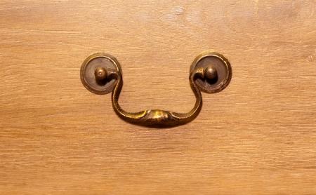 Bronze handle on wood closet photo