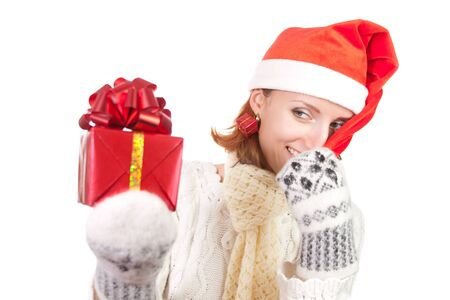 Happy smiling woman in christmas hat and mittens with gift. Isolated on white Stock Photo - 18426938
