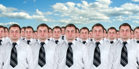 same: Many identical businessmen clones. Businessman production concept