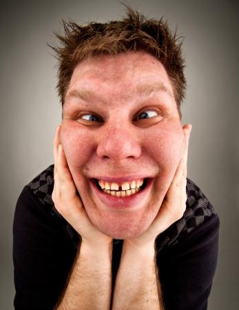 bizarre: Portrait of crazy bizarre man making faces Stock Photo