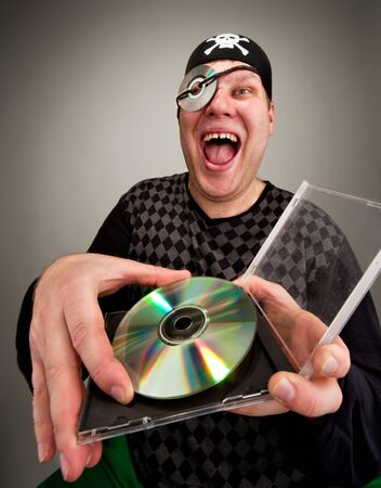 Portrait of laughing information pirate with computer disk Stock Photo - 18426943