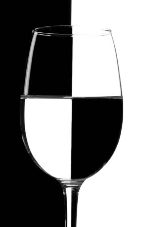 refraction of light: Glass of water against white and black background