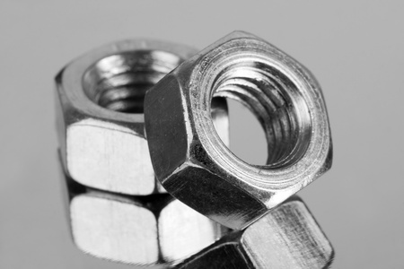 Close-up of two steel nuts. In B/W Stock Photo - 18430992