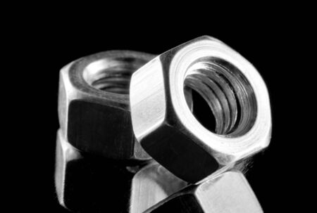 Close-up of two steel nuts. In B/W Stock Photo - 18430550