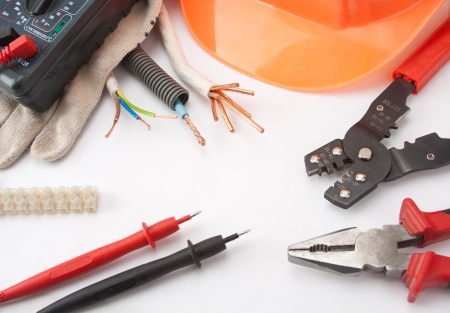 Electricians tools. Hardhat, multimeter, pliers, cutter, cables, etc.