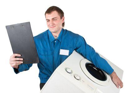 Repairman servicing washing machine. Isolated on white Stock Photo - 18426978