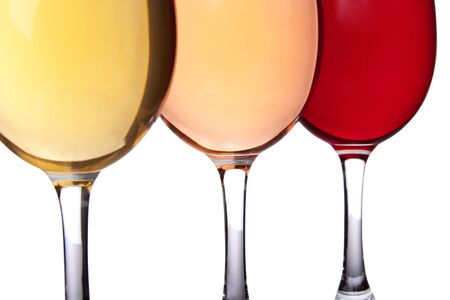 Close-up of three wineglasses. Yellow, pink and red photo