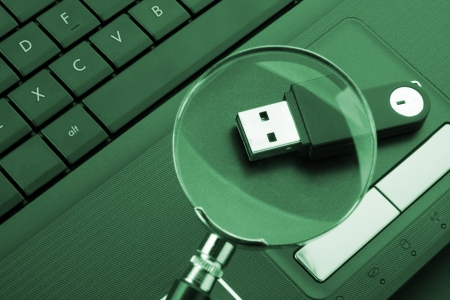 Magnifying glass focused on the removable flash drive Stock Photo - 18431301