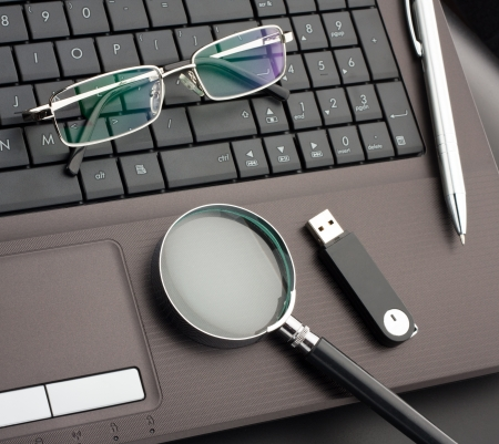 Business items on laptop computer Stock Photo - 18433717
