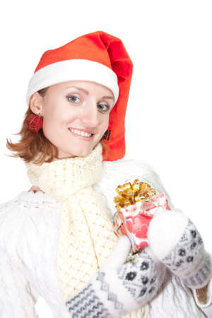 Happy smiling woman in christmas hat and mittens with gift. Isolated on white Stock Photo - 18477197