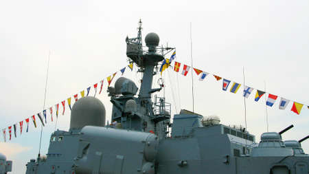 docked: Docked military battleship with flags