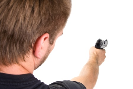 hombre disparando: Disparo. Aislado Foto de archivo